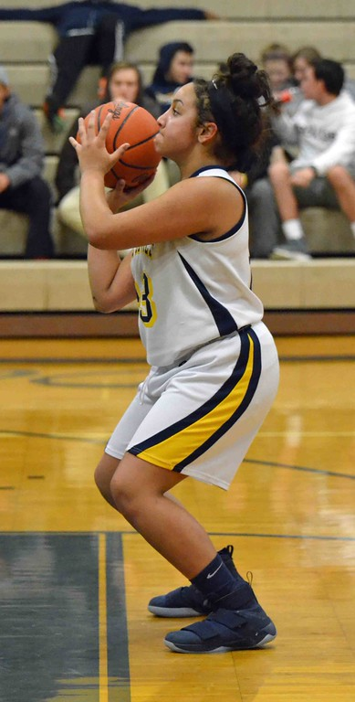 . Paul DiCicco - The News-Herald Wickliffe�s Stephanie Martin shooting a foul shot late in the game.