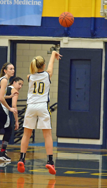 . Paul  DiCicco - The News-Herald Wickliffe�s Ana Stjepanovic, attempting a foul shot early in the game.