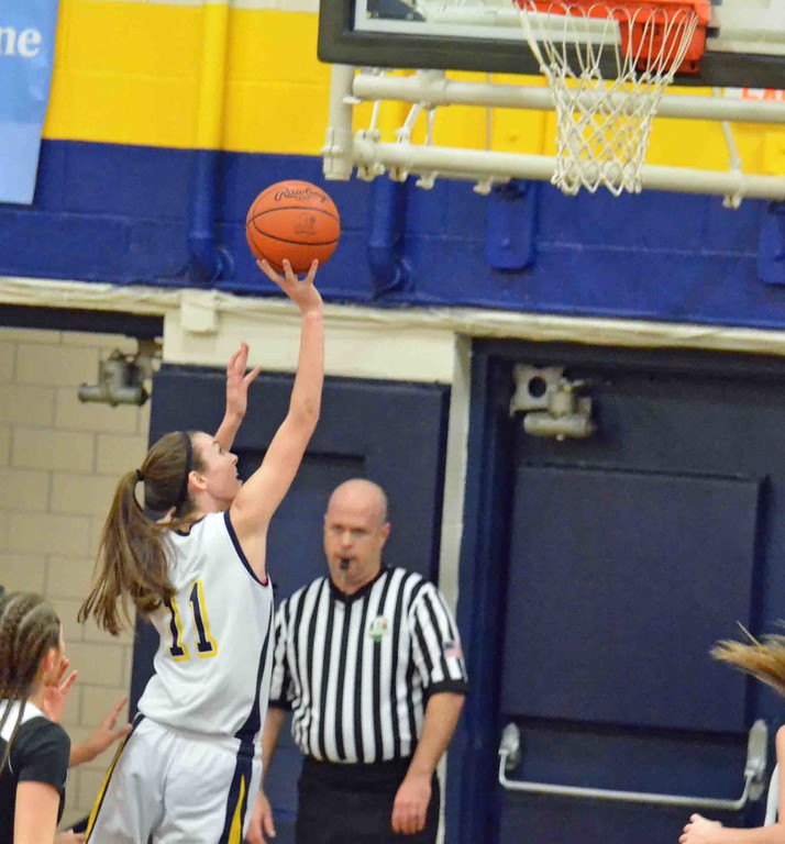 . Paul DiCicco - The News-Herald  Wickliffe�s Mary Burkett with a lay in.