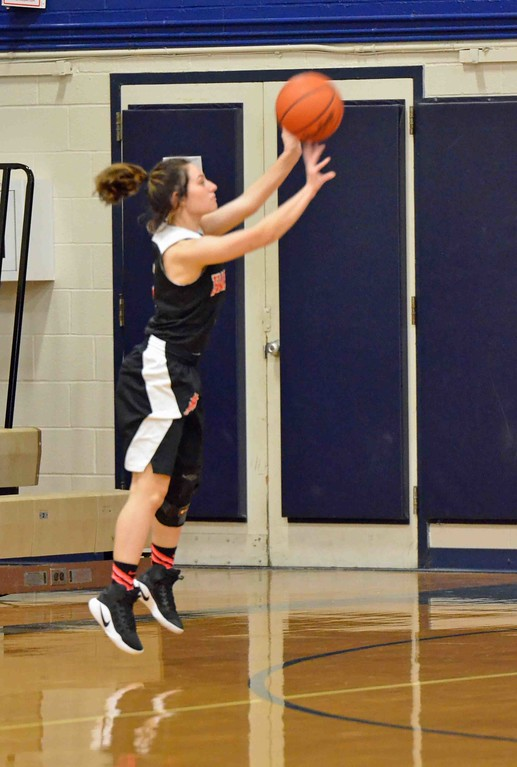 . Paul DiCicco - The News-Herald Harvey�s Danielle Cruz launching a 3-pointer from the corner.