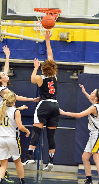. Paul DiCicco - The News-Herald Harvey�s Nevada Melton with an uncontested shot down the middle.