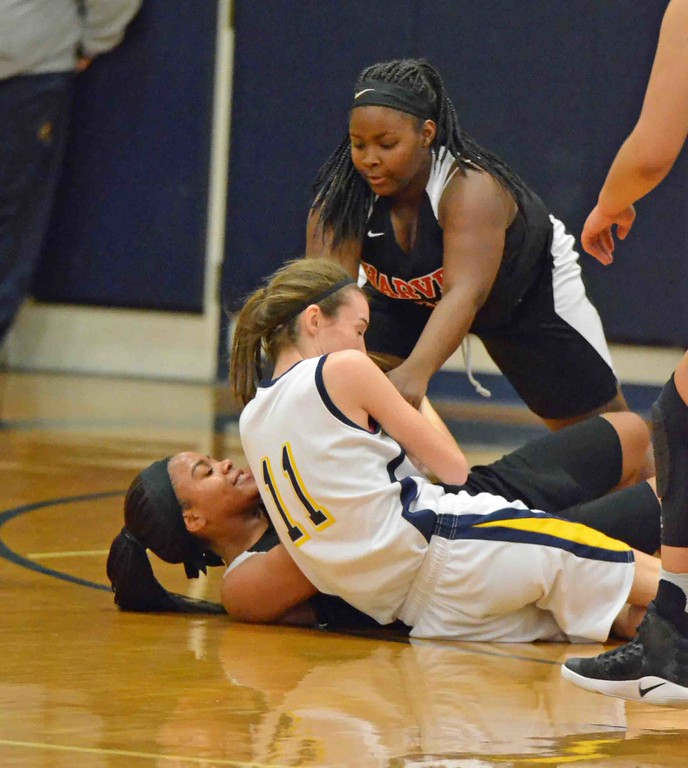 . Paul DiCicco - The News-Herald The players fight over possession early in the second quarter.