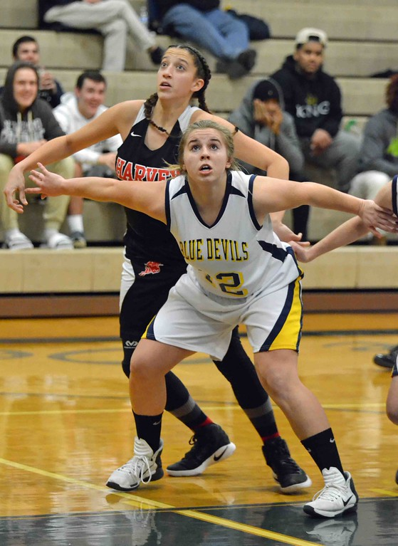 . Paul DiCicco - The News-Herald  Wickliffe�s Nicole Carroscia boxing out on a foul shot.
