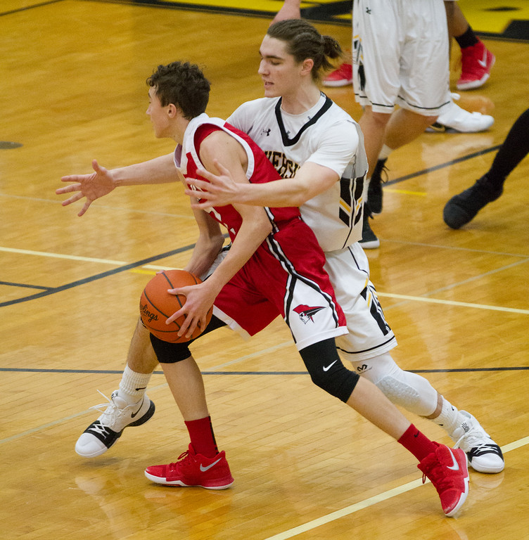 . Barry Booher- The News-Herald Riverside\'s Jameson Campbell pressures Perry\'s Drew Schiano on Jan. 13.