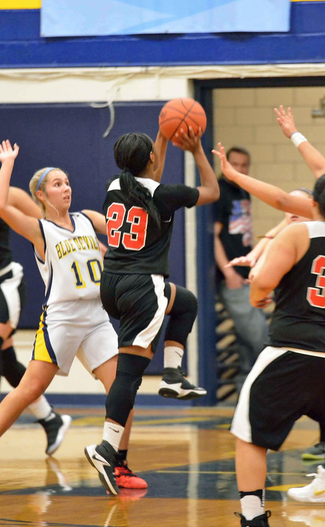 . Paul DiCicco - The News-Herald Harvey\'s Taharah Abdul Haqq attempts a shot late in the game as Wickliffe\'s Ana Stepanovic defends on Jan 13.