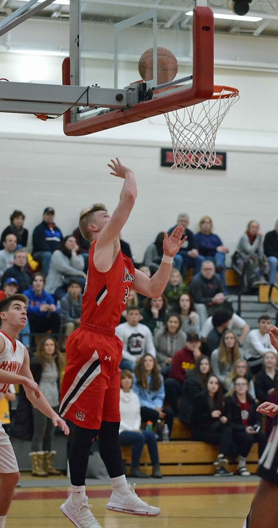 . Paul DiCicco - The News-Herald Chardon\'s Alex Sulka shoots and becomes the all-time leading scorer in school history on Jan 13.