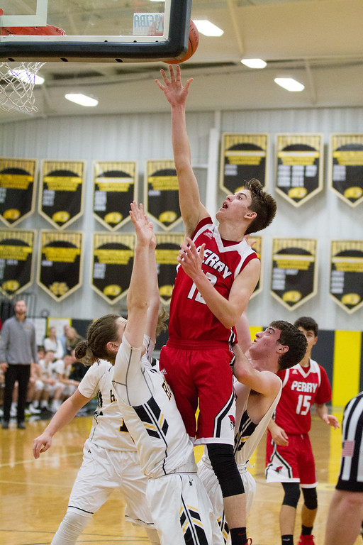 . Barry Booher- The News-Herald Perry\'s Jake Reid flips it over Riverside\'s Jameson Campbell on Jan. 13.
