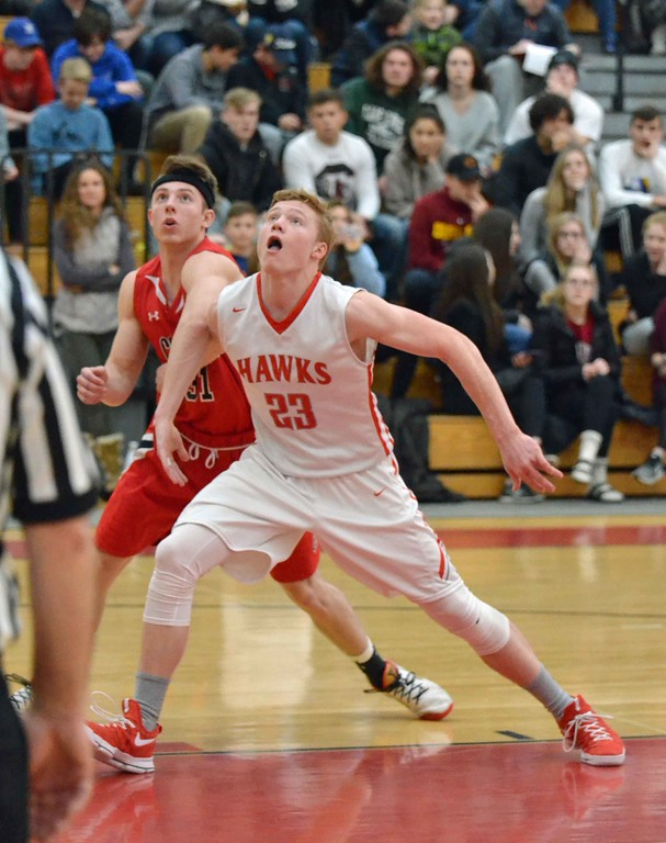 . Paul DiCicco - The News-Herald  Hawken\'s T.J. Perusek boxes out Chardon\'s Jake Skilton (31) after a foul shot attempt on Jan. 13.