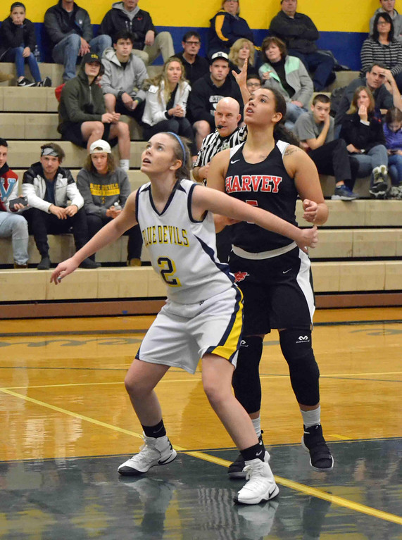 . Paul DiCicco - The News-Herald Wickliffe\'s Bridgette Burkette (2) boxes out Harvey\'s Nevada Melton on a foul shot  on Jan 13.