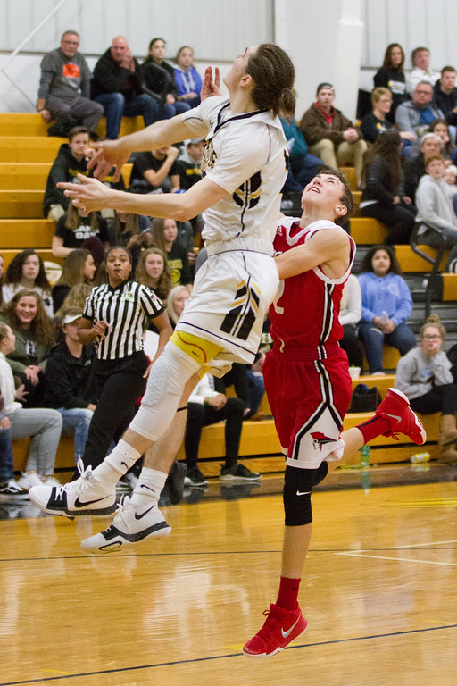 . Barry Booher- The News-Herald Riverside\'s Jameson Campbell blocks the layup attempt from Perry\'s Drew Schiano on Jan. 13.