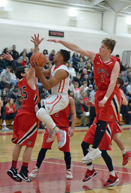 . Paul DiCicco - The News-Herald  Hawken\'s Hugh Brown drives on the Chardon defense on Jan. 13