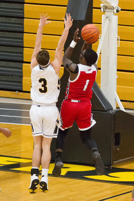 . Barry Booher- The News-Herald Perry\'s Jaylen Anderson shoots over Riverside\'s Michael Wojkowski on Jan. 13.