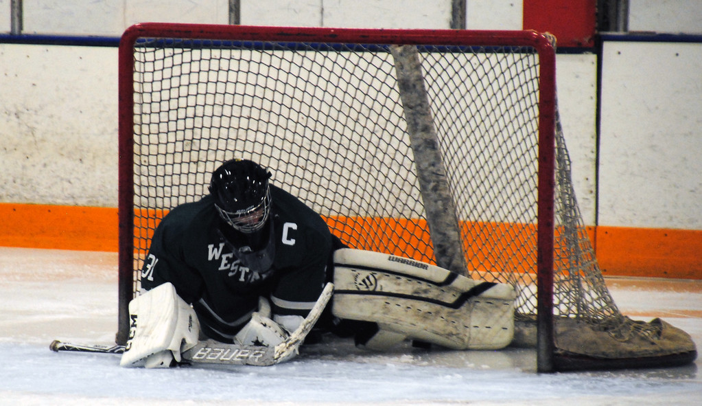 . Jon Behm - The Morning Journal<br> Westlake goalie Max Novak can\'t quite stop an Avon Lake goal in the second period of a Southwestern Conference Tournament first round game on Jan. 13.