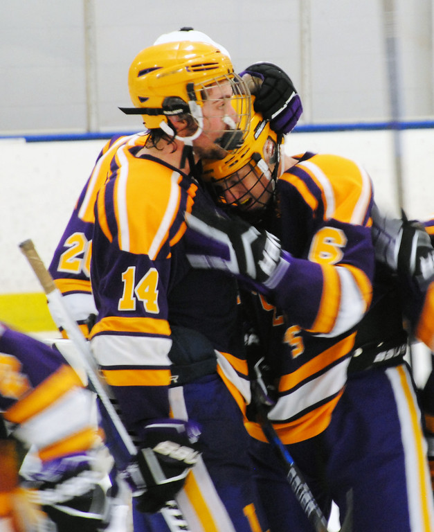 . Jon Behm - The Morning Journal<br> Lakewood\'s Will Holden (6) gets a hug from teammate Patrick Gilman after Holden scored a game-tying goal with one second remining in the third period against Avon during a Southwestern Conference Tournament first round game on Jan. 13.
