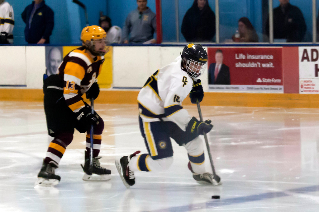 . Jen Forbus - The Morning Journal<br> Jackson McMahan of Olmsted Falls has control of the puck with Timothy Lubertozzi of Avon Lake close behind to challenge him on Jan. 14.