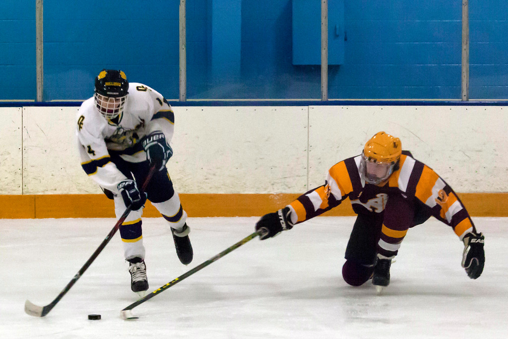 . Jen Forbus - The Morning Journal<br> Olmsted Falls\'s Max Kirth-Gruszczynski and Avon Lake\'s Connor Wing vie for the puck in a Southwestern Conference tournament quarterfinal on Jan. 14.
