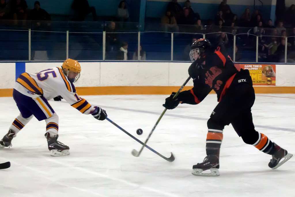 . Jen Forbus - The Morning Journal<br> Lakewood\'s Jonas Hupcey and North Olmsted\'s Travis Vitaz clash for possession of the puck on Jan. 14.