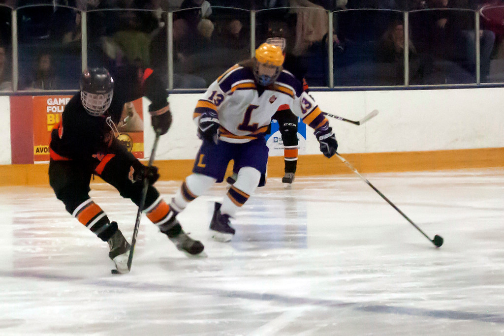 . Jen Forbus - The Morning Journal<br> North Olmsted\'s Riley Vertosnik is in total control of the puck against Lakewood on Jan. 14.