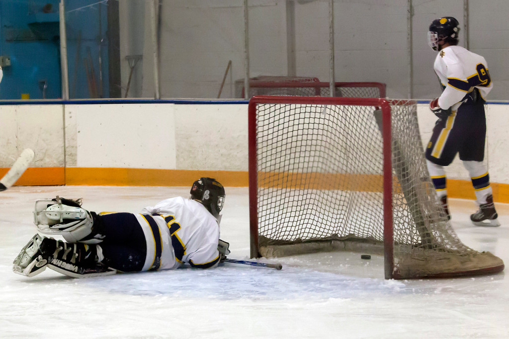 . Jen Forbus - The Morning Journal<br> Olmsted Falls goalie Angelo Hanson looks back at the puck that made it past him into the net against Avon Lake on Jan. 14.