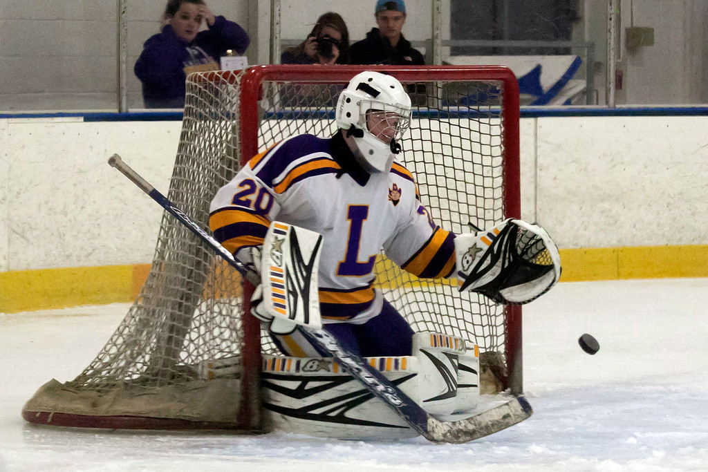 . Jen Forbus - The Morning Journal<br> Lakewood goalie Rob Holden isn\'t going to let the puck past him into the net against Norht Olmsted on Jan. 14.