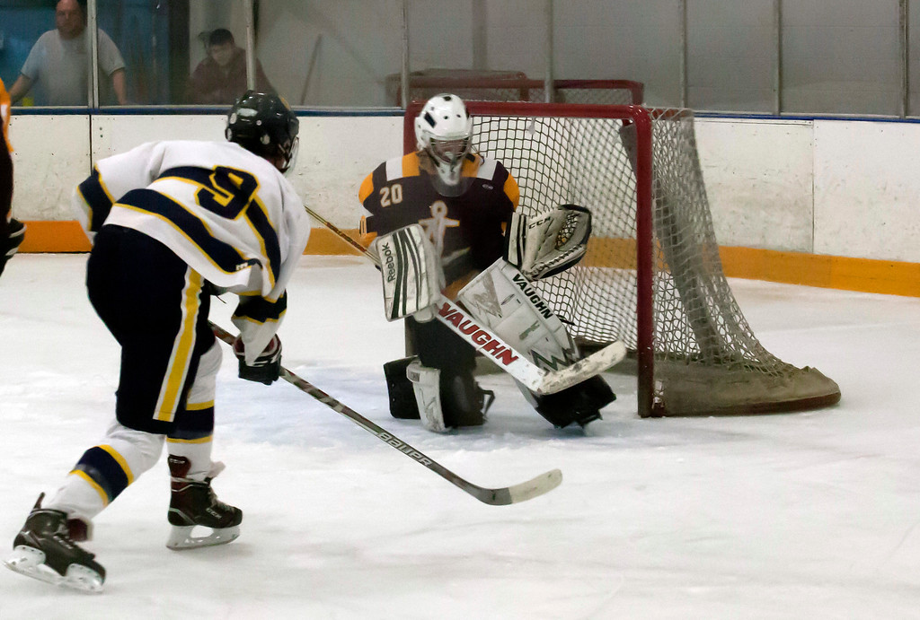 . Jen Forbus - The Morning Journal<br> Olmsted Falls\' Dominic Conte takes aim at goal as Shoreman goalie Dillon Aslaksen prepares for the shot on Jan. 14.