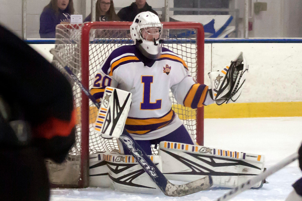 . Jen Forbus - The Morning Journal<br> Lakewood goalie Rob Holden makes one of his 44 saves during a game against North Olmsted on Jan. 14.