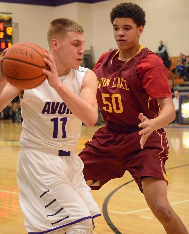 . Eric Bonzar�The Morning Journal Avon Lake center Barris Coleman plays tight defense on Avon\'s Jason Santora, Jan. 15, 2016.