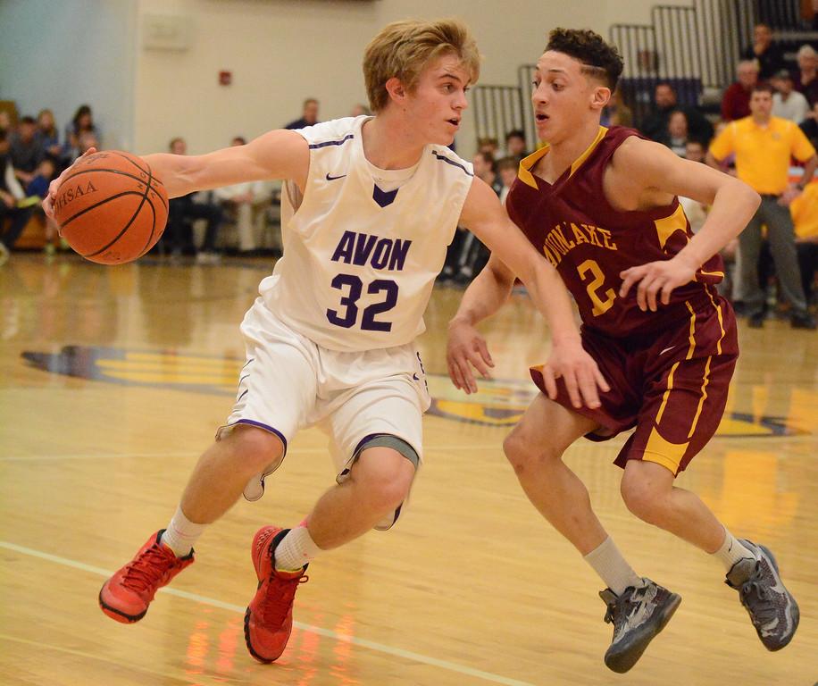 . Eric Bonzar�The Morning Journal Avon point guard Ryan Maloy dribbles up the court past Avon Lake guard Jordan Ball, Jan. 15, 2016.