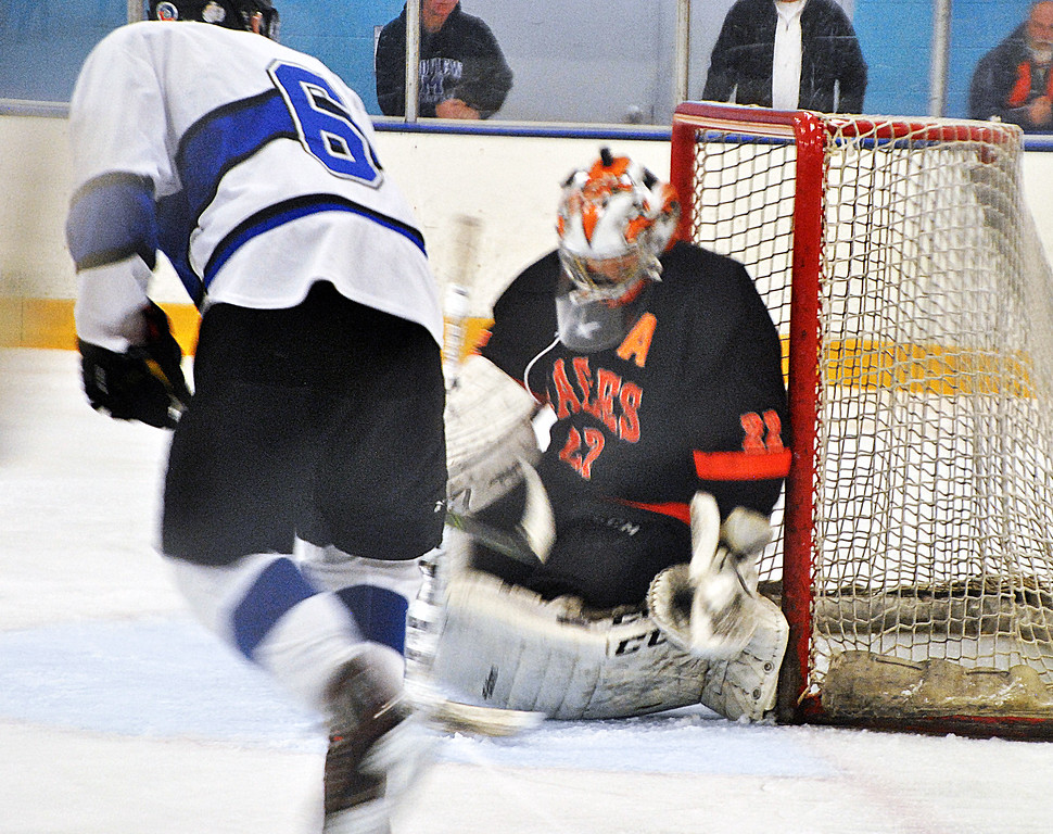 . Jon Behm - The Morning Journal Norht Olmsted goalie Ryan Godin makes a save on a backhanded shot by Midview senior Jacob Scheetz (6) during the second period of a SWC tournament semifinal at the North Olmsted Recreation Center on Jan. 15.