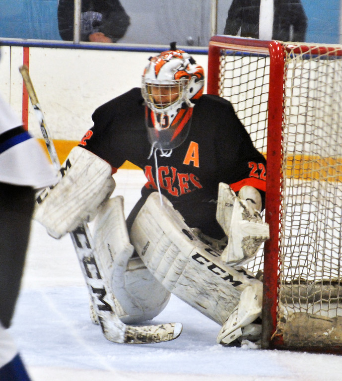 . Jon Behm - The Morning Journal North Olmsted goalie Ryan Godin prepares for a shot during the second period of a SWC tournament semifinal game against Midview at the North Olmsted Recreation Center on Jan. 15.