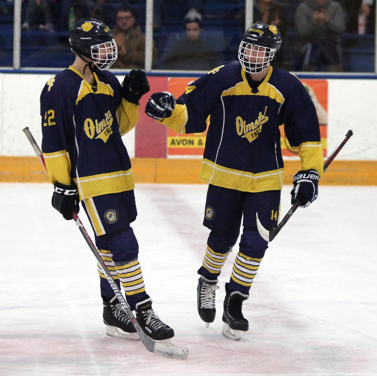 . Randy Meyers - The Morning Journal<br> Max Kirth-Gruszczynski is congratulated by his brother, Mike, after scoring a goal against Midview during a Southwestern Conference tournament semifinal on Jan. 15.