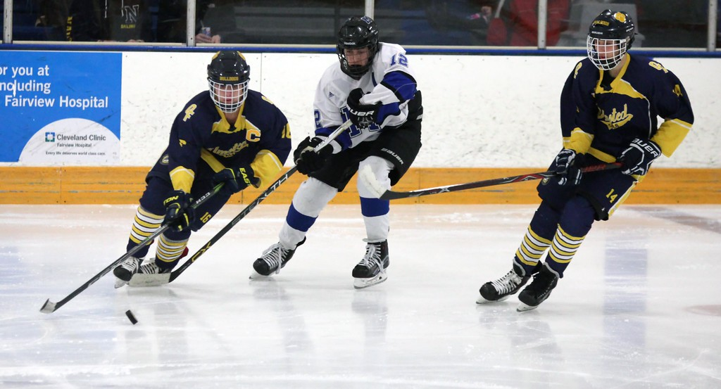 . Randy Meyers - The Morning Journal<br> Jacob Kerkay of Olmsted Falls pushes the puck past Nicholas Verlotti of Midview during the first period of a Southwestern Conference tournament semifinal on Jan. 15.