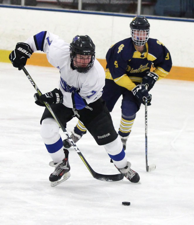 . Randy Meyers - The Morning Journal<br> Robby Rodgers of Midview moves the puck away from Dominic Conte of Olmsted Falls during a Southwestern Conference tournament semifinal on Jan. 15.