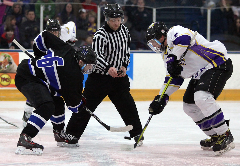 . Randy Myers - The Morning Journal Avon\'s Shane Docherty and Midview\'s   Jacob Scheetz face- off to start the first period of the Southwest   Conference championship on Jan. 16.