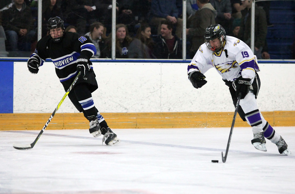 . Randy Myers - The Morning Journal Zach Zwiercki of Avon takes control of the puck next to Midview\'s Brody Rodgers during the first period on Jan. 16.