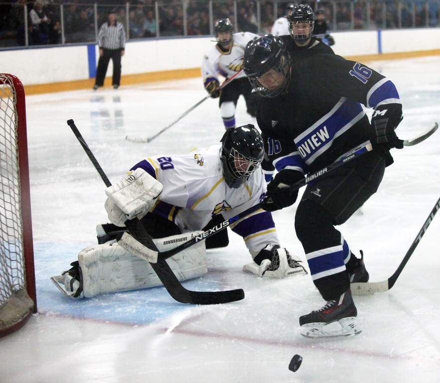 . Randy Myers - The Morning Journal A shot on goal by Midviw\'s Devon  Lichtler is blocked by Avon goalie Danny Fielding during Monday\'s  Southwest  Conference championship game on Jan. 16.
