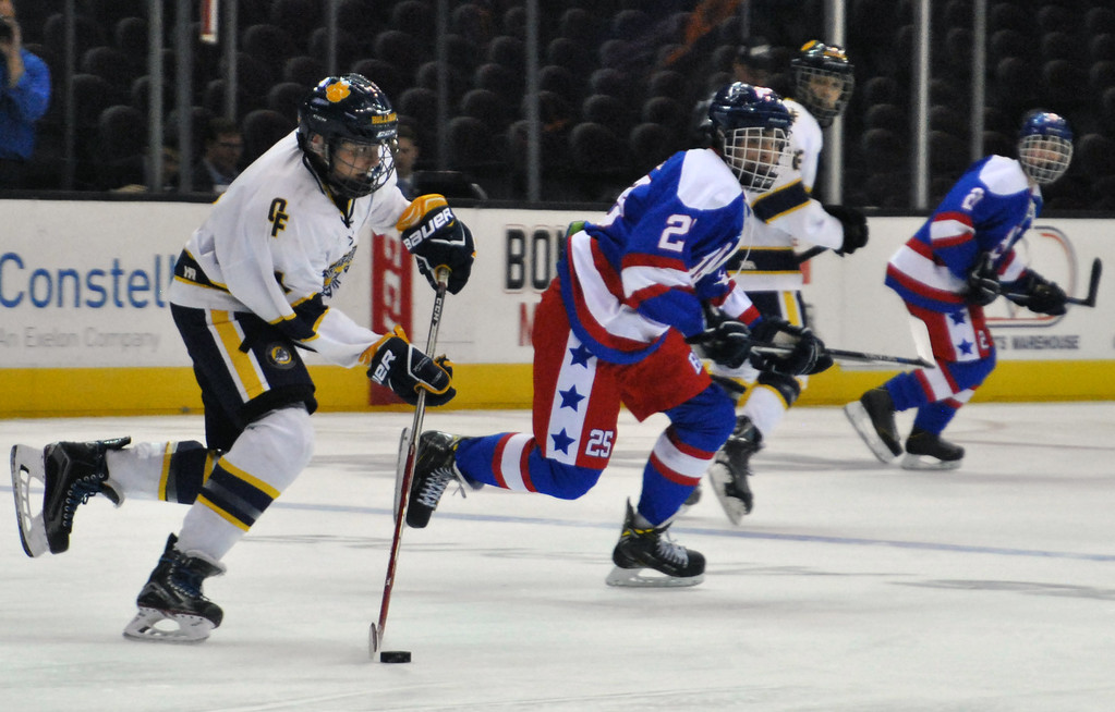 . Jon Behm - The Morning Journal Olmsted Falls freshman Matt Heine looks for an open teammate during the first period against Bay on Jan. 20 at Quicken Loans Arena.