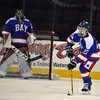 Jon Behm - The Morning Journal<br /> Bay junior Will Kenney looks for an outlet pass as goalie Spencer O'Connell watches in the background during the third period against Olmsted Falls on Jan. 20 at Quicken Loans Arena.