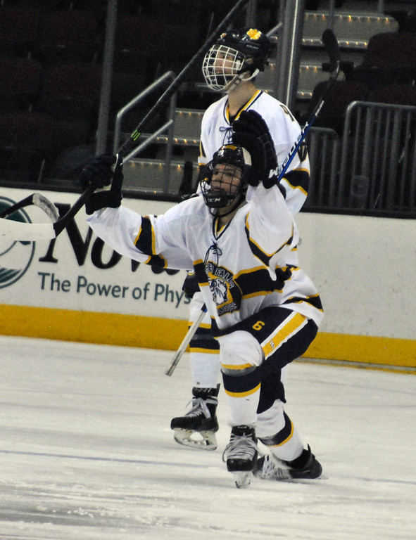. Jon Behm - The Morning Journal Olmsted Falls freshman Colin Wilson celbrates his goal in the first period against Bay on Jan. 20 at Quicken Loans Arena.