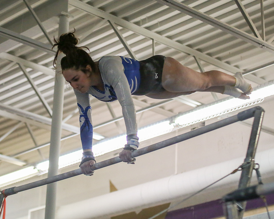 . Coleen Moskowitz - The News-Herald Madison\'s Gabby Blackford, first on the bars at the Western Reserve Conference gymnastics meet on Jan. 21.