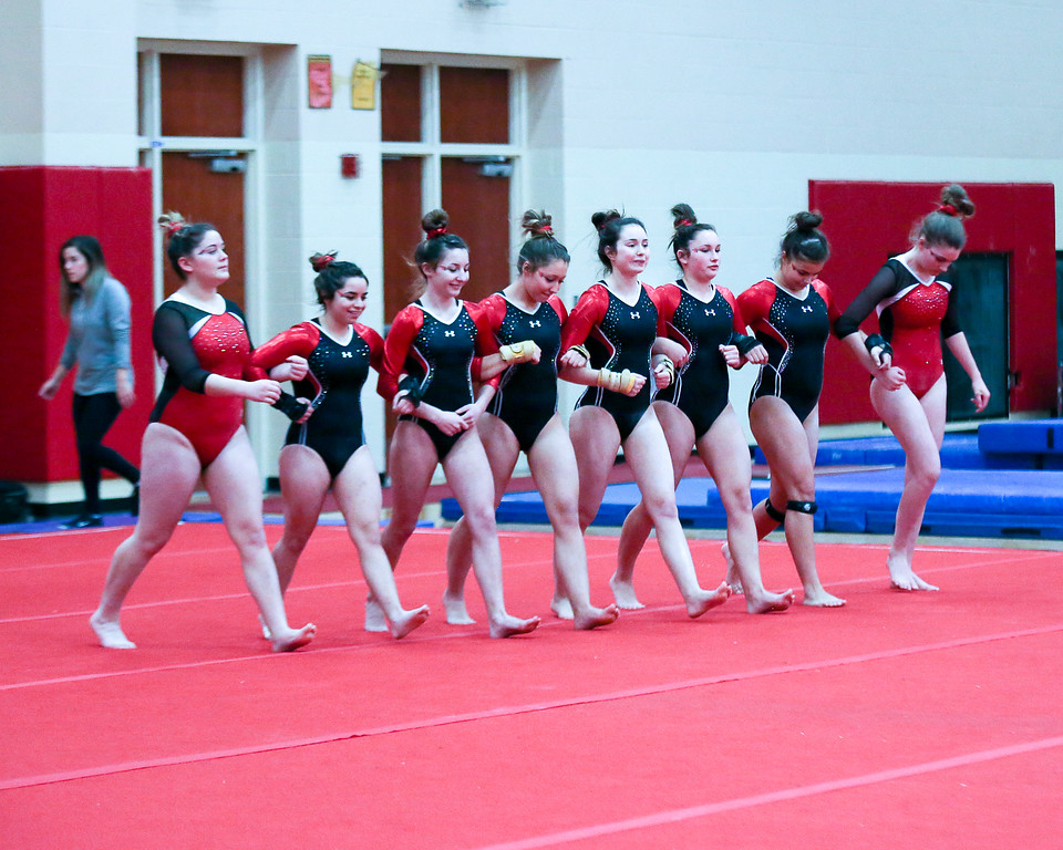 . Coleen Moskowitz - The News-Herald Perry and Mentor gymnasts head to greet judges on the floor during the Rock n\' Roll Classic on Jan. 21 at Brecksville-Broadview Heights.