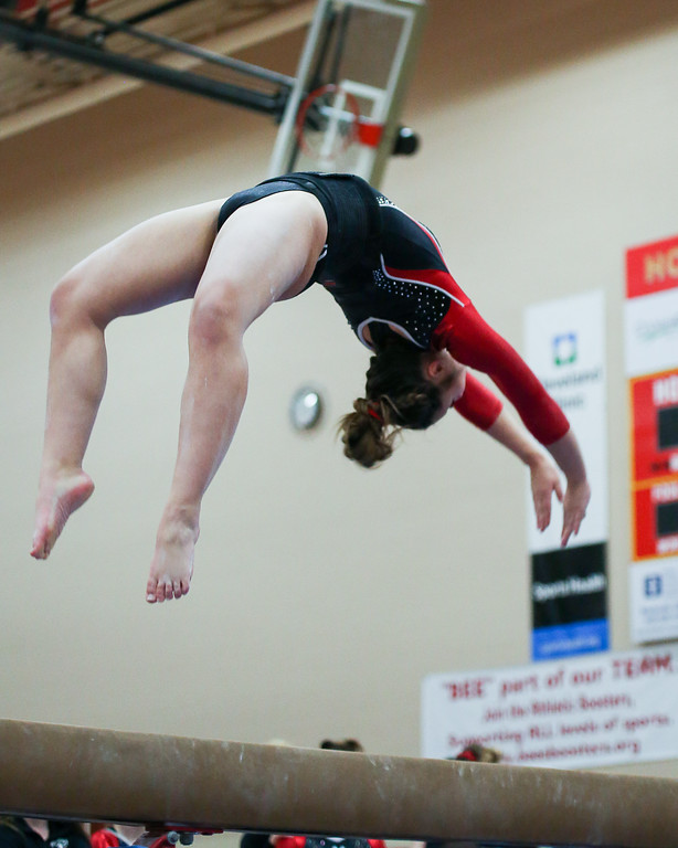 . Coleen Moskowitz - The News-Herald Olivia Wilson of Mentor on the beam during the Rock n\' Roll Classic on Jan. 21 at Brecksville-Broadview Heights.