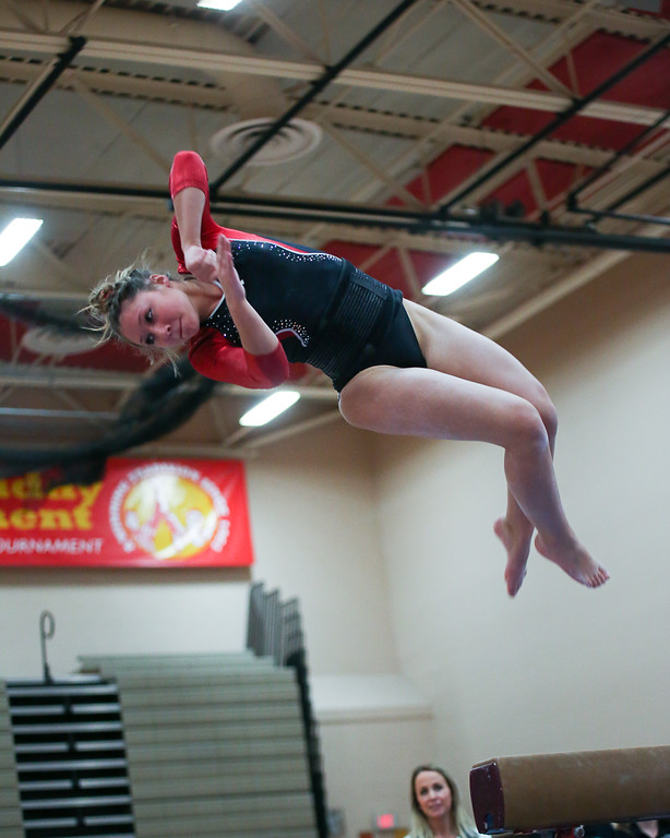 . Coleen Moskowitz - The News-Herald Alyssa Taglieri of Mentor on the beam dismount during the Rock n\' Roll Classic on Jan. 21 at Brecksville-Broadview Heights.