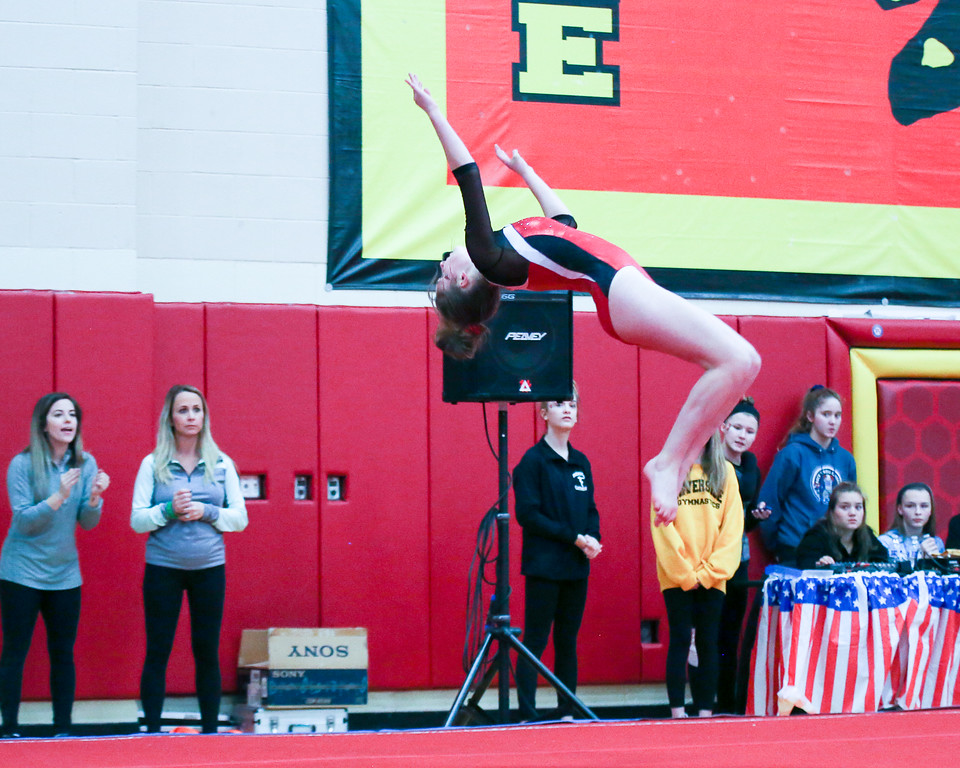 . Coleen Moskowitz - The News-Herald Cady Cousins Perry performs a back tuck during the Rock n\' Roll Classic on Jan. 21 at Brecksville-Broadview Heights.