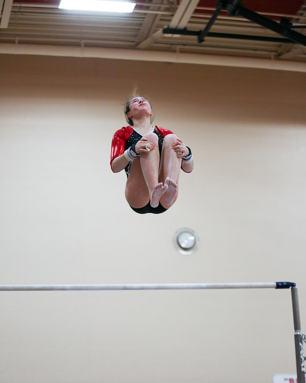 . Coleen Moskowitz - The News-Herald Alyssa Taglieri of Mentor on the bars during the Rock n\' Roll Classic on Jan. 21 at Brecksville-Broadview Heights.