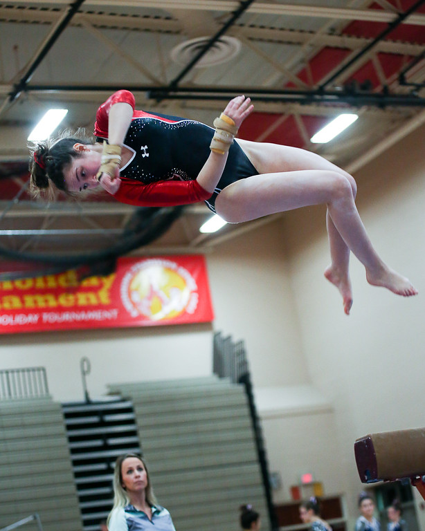 . Coleen Moskowitz - The News-Herald Miranda Butterfield of Mentor on the beam dismount during the Rock n\' Roll Classic on Jan. 21 at Brecksville-Broadview Heights.