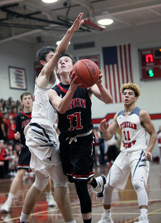 . Randy Myers - The Morning Journal Fairview\'s Aiden Salupo is fouled   on the drive by Michael Berghaus of Lutheran West during the second  quarter  on Monday.