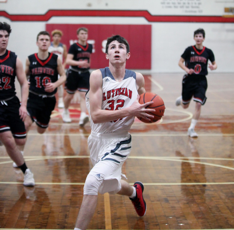 . Randy Myers - The Morning Journal Lutheran West\'s Michael Berghaus  scores on a fast break ahead of the Fairview defense during the first  quarter on Monday