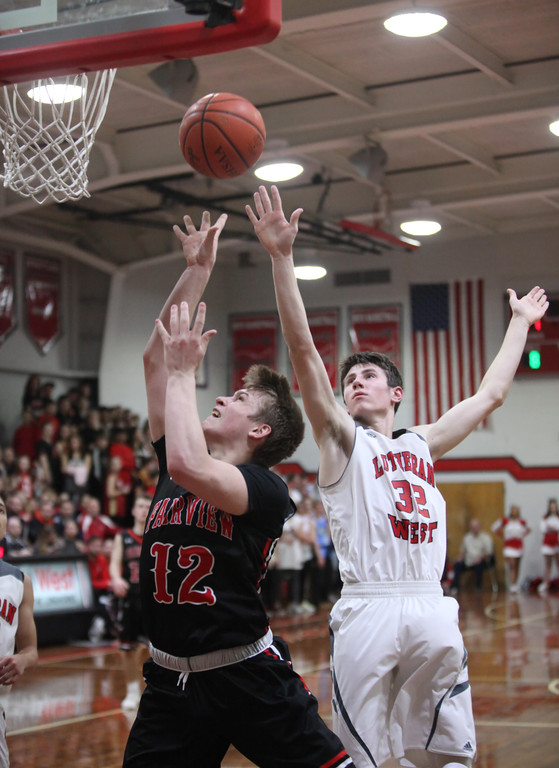 . Randy Myers - The Morning Journal Fairview\'s Luke Howes drives and   scores against Michael Berghaus of Lutheran West during the second quarter   on Monday