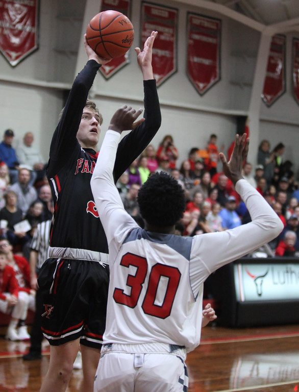 . Randy Myers - The Morning Journal Fairview\'s Colin Caja scores on a   turn around jump shot over Desean Sales of Lutheran West during the second   quarter